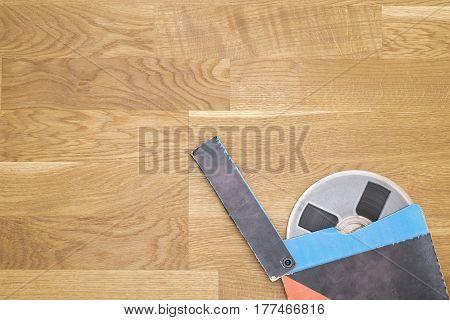 Vintage magnetic audio tape, reel to reel type, paper box on the grunge wooden floor
