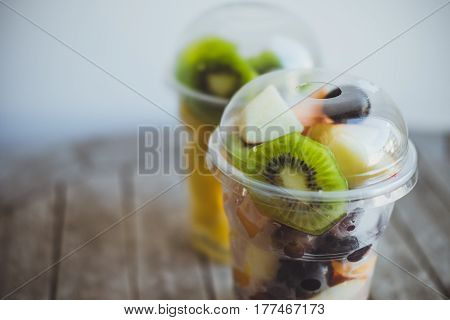 Fresh Fruits In Plastic Cups For Takeaway: Kiwi, Pineapple, Tangerines, Apples, Melon In Plastic Cup