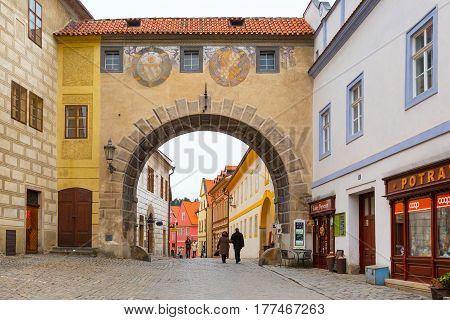 Cesky Krumlov, Czech Republic - February 26, 2017: Famous landmark, historic center street view with arch