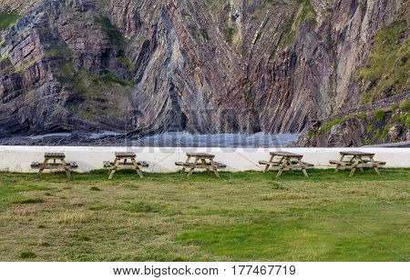 Tables of the pub on the street in the picturesque place of Hartland Quay. Devon. England