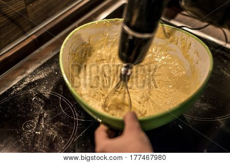 hands making duff pastry of egg in bowl to make fresh waffles