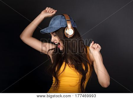 Beautiful Emotional Dancing And Singing Young Woman Listening The Music In Wireless Headphone In Blu