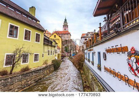 Cesky Krumlov, Czech Republic - February 26, 2017: Famous landmark, historic center street and castle tower view