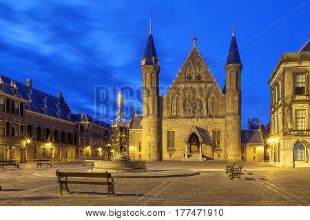 Illuminated gothic facade of Ridderzaal in Binnenhof Hague Netherlands