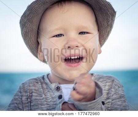Outdoor portrait of a happy boy