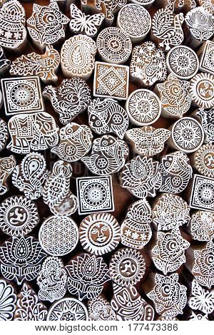 Symbols leaves sun sea fish on wooden surface of mold blocks for traditional printing textile. Popular design in India