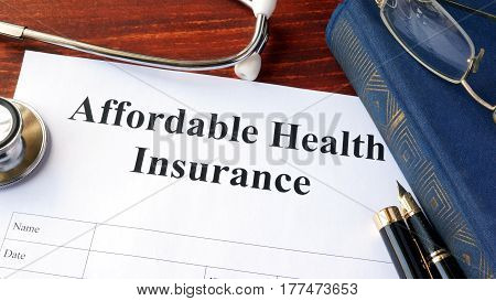 Affordable health insurance form on a table.