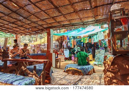 GOA, INDIA - MAR 1, 2017: People having rest inside village style cafe in indian crowded resort town on March 1, 2017. Near 5 million tourists visit Goa annually