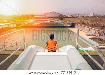 waterpark in asia whith sunset boy on water slide