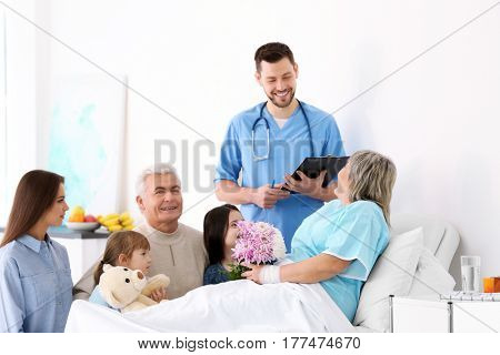 Family visiting grandmother in hospital