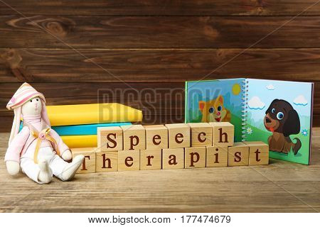 Wooden blocks with space for text on table. Concept of child's speech therapist