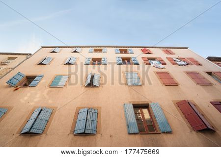 Exterior wall with many windows and shutters building and architecture Narbonne France.
