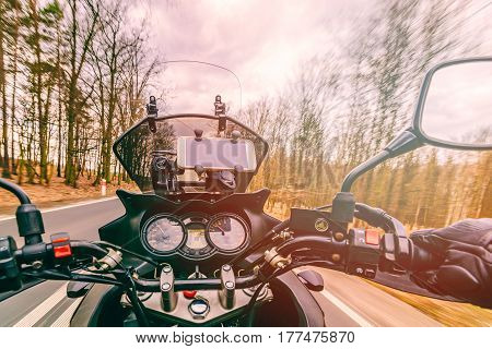 Driving A Motorcycle At Spring At The Asphalt Road