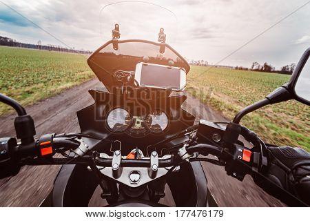 Driving A Motorcycle At Spring At The Dirt Road.