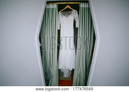 the wall hanging and a long white wedding dress