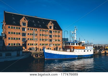 COPENHAGEN DENMARK - MARCH 11 2017: Copenhagen Denmark typical architecture. Picture is depicting 71 Nyhavn Hotel housed in a 200-year-old canalside warehouse.
