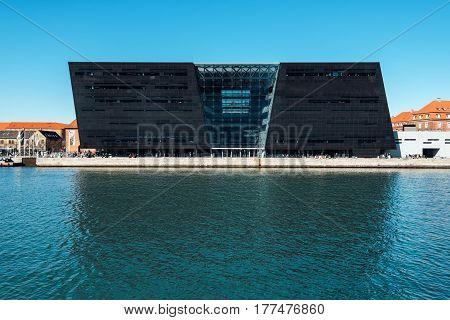 COPENHAGEN DENMARK - MARCH 11 2017: Black Diamond modern waterfront extension to the Royal Danish Library in Copenhagen. Designed by Danish architects Schmidt Hammer Lassen.