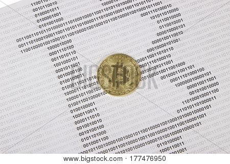 gold bitcoin on the background of binary code. electronic money and cryptocurrency