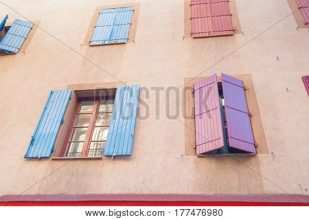 Shuttered windows on exterior wall building and architecture Narbonne France.