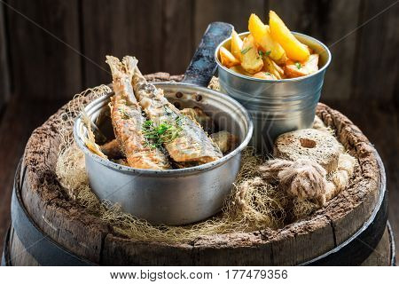 Fresh Herring Fish And Chips With Herbs And Salt