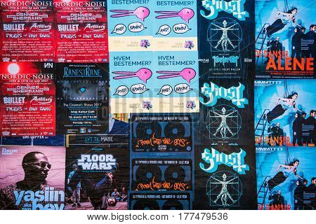 COPENHAGEN DENMARK - MARCH 11 2017: Posters for various music concert in Copenhagen Denmark. Danish capital flourishing scenes increasingly attracts visitors.