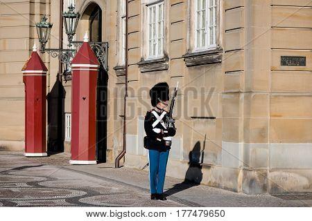 COPENHAGEN DENMARK - MARCH 11 2017: Amalienborg Palace Copenhagen. Royal Life Guards (Danish: Den Kongelige Livgarde) infantry regiment of Denmark Army founded in 1658 by King Frederik III