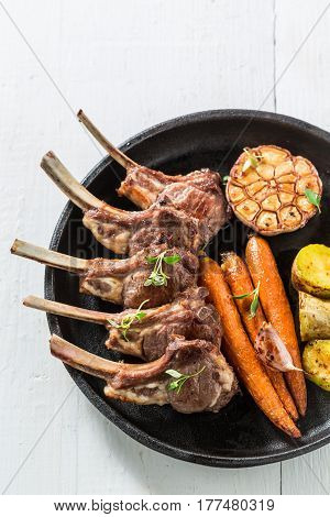 Delicious Grilled Ribs Of Lamb On An Old White Table