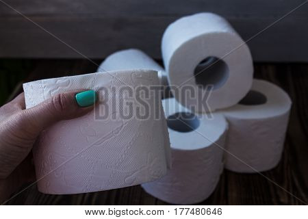 a lot of toilet paper and a hand