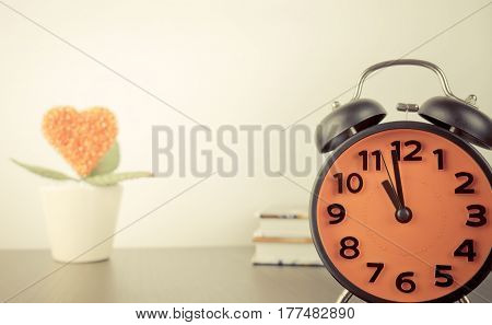 Alarm clock with love concept flower on the backgorund