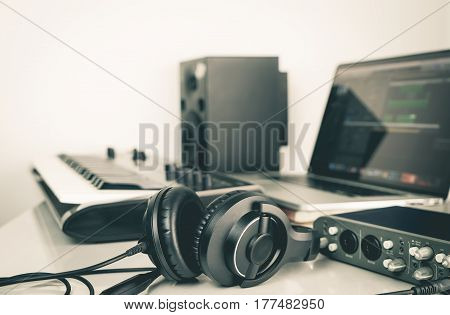 Music headphone lying on Music studio working desktop
