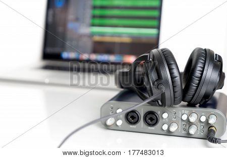 Black Music Studio headphone lying on Computer Sound interface