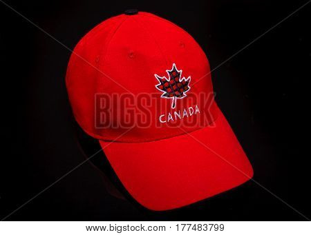 PLEASANT VALLEY CANADA - MARCH 10 2017: Red ball cap adorned with Canadian maple leaf showing national pride.