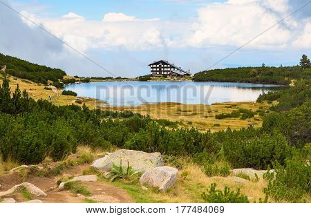 Beautiful summer landscape with lake and house at Bezbog in Bulgaria, Bansko