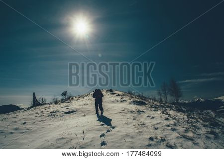 tourists hikers traveling on the snowy mountains to the top , the concept of the path to purpose and success