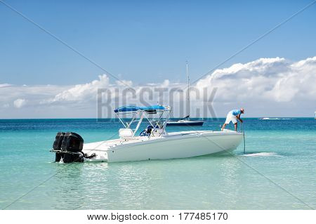 Man, Yachtsman On Motorboat On Water, In St. John, Antigua