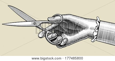 Woman's hand with scissors. Vintage engraving stylized drawing