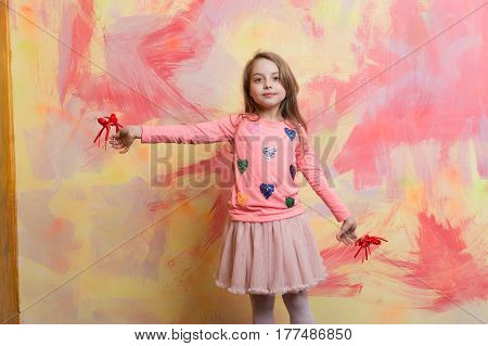 Small Happy Baby Girl Holding Valentines Day Decorative Red Hearts