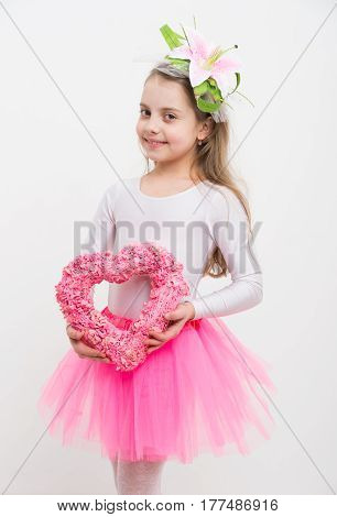 Small Happy Girl With Lily In Hair Holding Pink Heart