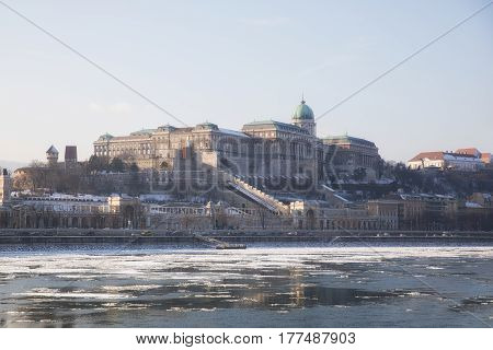 Frozen Danube river in Hungary with castle of Buda