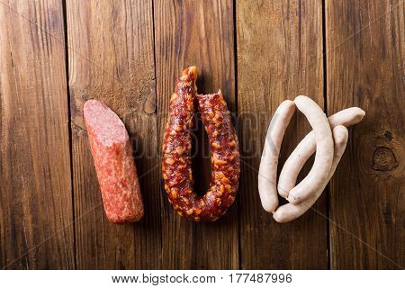 Homemade sausages on a wooden background. Sausages. White sausages. Sausages and salami.