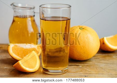 Orange Homemade Kombucha In A Decanter On A Wooden Table