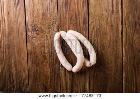 Homemade sausages on a wooden background. Sausages. White sausages