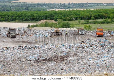 Truck Working In Landfill With Birds Looking For Food. Garbage On The City Dump. Soil Pollution. Env