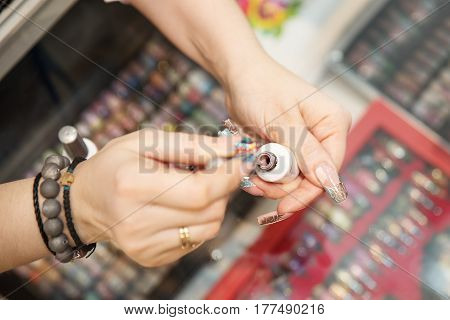 Professional Manicurist Showing Colorful Nail Polish To Check The Finish Result. Beauty And Fashion