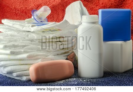 accessories for baby diapers on white background, banny, a bottle of water, cream