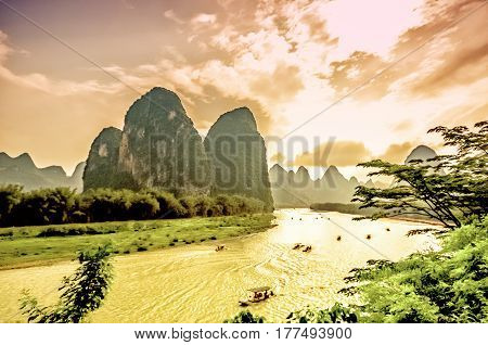 view with sunset over Li river by Yangshuo in China
