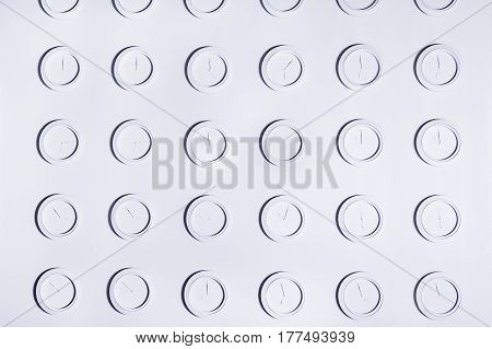 Design White Wall With Identical Round White Not Numeral Wall Clocks. Time Concept Background
