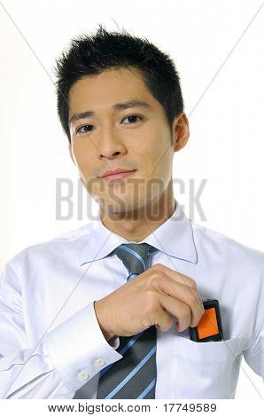 asian business man smsing on a hand phone