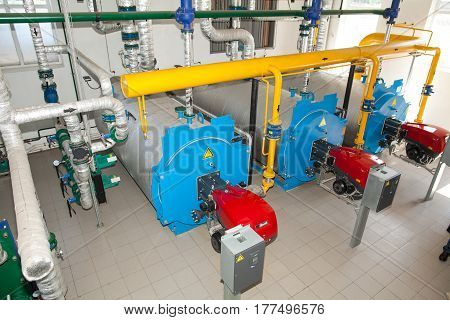 Modern boiler room equipment- high power boiler burner. Water heating. Power supply. the equipment at the industrial enterprise. power efficiency concept.
