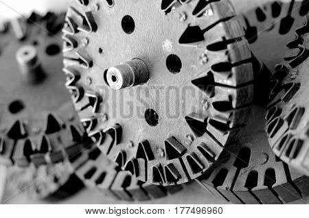 Black and white machine gears stock with light